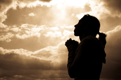 woman praying silhoutte
